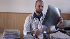 Stock Video Footage of Man doctor with radiography X ray interpretation, advising, writing, examination