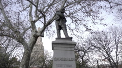 Garibaldi statue close-up on cold fall day with bare trees in Washington Square Stock Footage