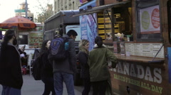 NYU students laughing outside empanada food truck Green Street Greenwich Village Stock Footage