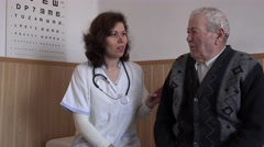 Stock Video Footage of Smiling female doctor talking with senior patient 4K, medic examination, ill man