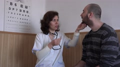 Woman doctor with young patient, regular medical examination calcium level check Stock Footage