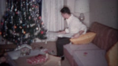1964: Teenager gets shotgun for Christmas gift.  PLANO, TEXAS Stock Footage