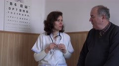 Smiling adult woman doctor talking with patient in medical office encouraging 4K Stock Footage