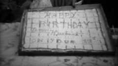 1961: Grandpa celebrating 85th birthday party cutting large square cake.  Stock Footage