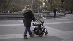 Washington Square Park on beautiful fall day, woman pushing stroller NYC 1080 HD Stock Footage