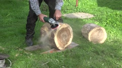 Man hand with electric sander tool sand wood oak tree log. Closeup. 4K Stock Footage