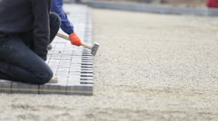 Worker puts paving - stock footage