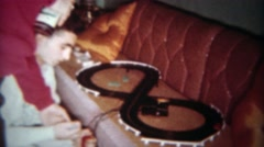 1962: Slot car race track makeshift setup on brown living room couch.  BUFFALO, Stock Footage