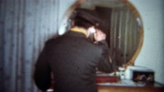 1963: Suave military man turns around from primping in bedroom mirror. BUFFALO, - stock footage