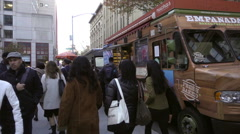 Zooming in on Indian man purchasing empanadas food truck street slow motion NYC Stock Footage