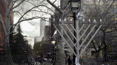Zooming out from giant Menorah in Washington Square Park with Freedom Tower NYC Stock Footage