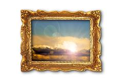 colorful sky image in ancient gilded painting frame; the image with the cloud - stock photo