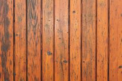 Weathered orange fir planks on wall, texture for your architectural design Stock Photos