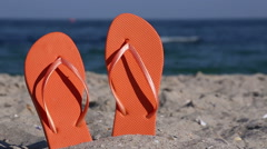Flip-flops on the beach Stock Footage