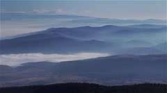 Hills and valleys covered with thick white fog Stock Footage