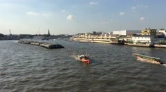 Chao Phraya river view from the memorial bridge with a big cargo ship passing by - stock footage