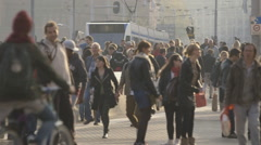 People in front of Amsterdam Centraal train station - graded Stock Footage