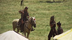Reconstruction of the ancient Bulgarian warriors on a horse in slow motion Stock Footage