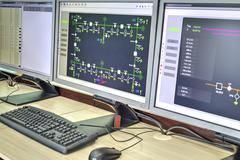 Monitors with schematic diagram for supervisory, control and data acquisition Kuvituskuvat