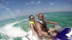 Young Couple on Jet Ski, Tropical Ocean, Vacation Concept Stock Footage