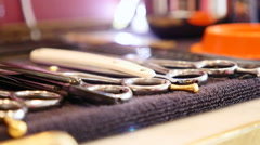 Scissors placed in a barber table Stock Footage