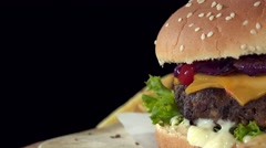 Homemade Cheeseburger (seamless loopable 4K footage) - stock footage