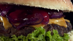 Stock Video Footage of Homemade Cheeseburger (seamless loopable 4K footage)