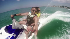 Couple drive on the jet ski above the water Stock Footage