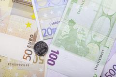 one ruble coin and a Euro banknotes close up - stock photo