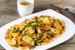 Chinese stir fry sticky rice slices and vegetable dish ready to eat Stock Photos