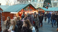 Christmas Market Crowded Pedestrian Street Downtown  People Shopping slow motion - stock footage