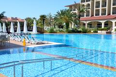 Stock Photo of Swimming pool with entrance for disabled persons at luxury hotel, Antalya, Tu
