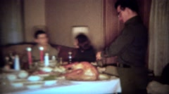 1964: Father carving turkey for intimate holiday candlelight dinner feast. Stock Footage