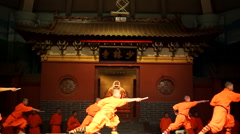 Shaolin temple monks are practicing martial skills on the stage for the tourists Stock Footage
