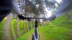 Bike downhill fast ride on narrow path, POV Stock Footage