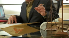 Lawyer working in his modern office focus on scales of justice 4k Stock Footage