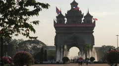 Tourists walking in Patuxai park,Vientiane,Laos Stock Footage