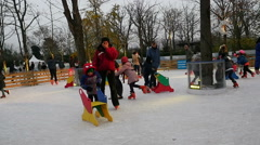 Slow motion Ice scatting on Christmas Market ice rink in Paris, France - stock footage
