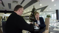 Man drinking coffee. In the background a Christmas tree. - stock footage