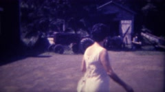 Stock Video Footage of 1963: Modern urban women visits her childhood tractor farm. DES MOINES, IOWA