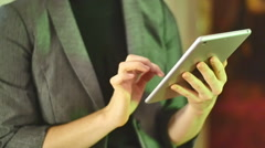 Woman looking at ipad touchpad device Stock Footage