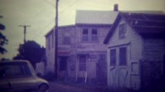 1971: Abandoned and boarded up homes start as people move out of the rust belt. Stock Footage
