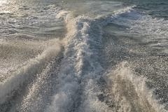 Boat wake, trail in sea after fast moving Kuvituskuvat