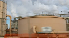 Driving next to an oil industrial complex 4k Stock Footage