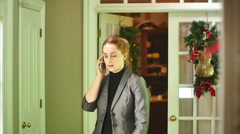 Woman on phone during christmas business realator realotor relitor Stock Footage