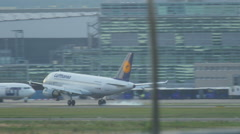 Lufthansa Airbus 320 D-AIBF, landing on runway. Slow motion. Stock Footage