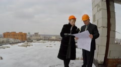 Stock Video Footage of Construction in winter. Professional people at work.