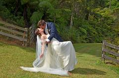 Husband and wife kiss on their wedding Day outdoors - stock photo