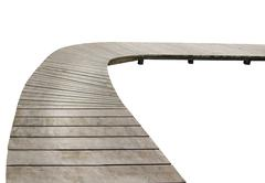 Wooden boardwalk curve - stock photo