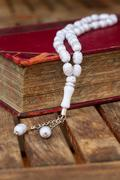 Holy Quran with beads - stock photo